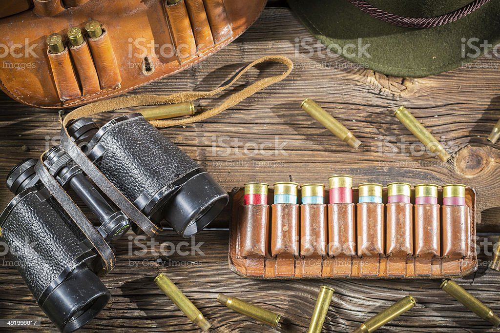 Belt with hunter bullets and binocular stock photo