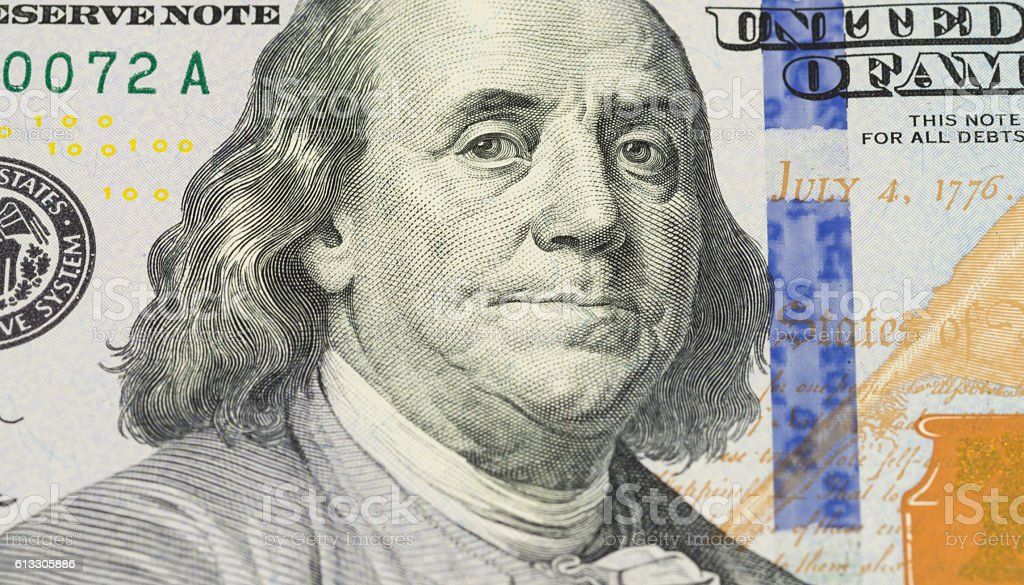 Ben Franklin face on us 100 dollar bill extreme macro stock photo