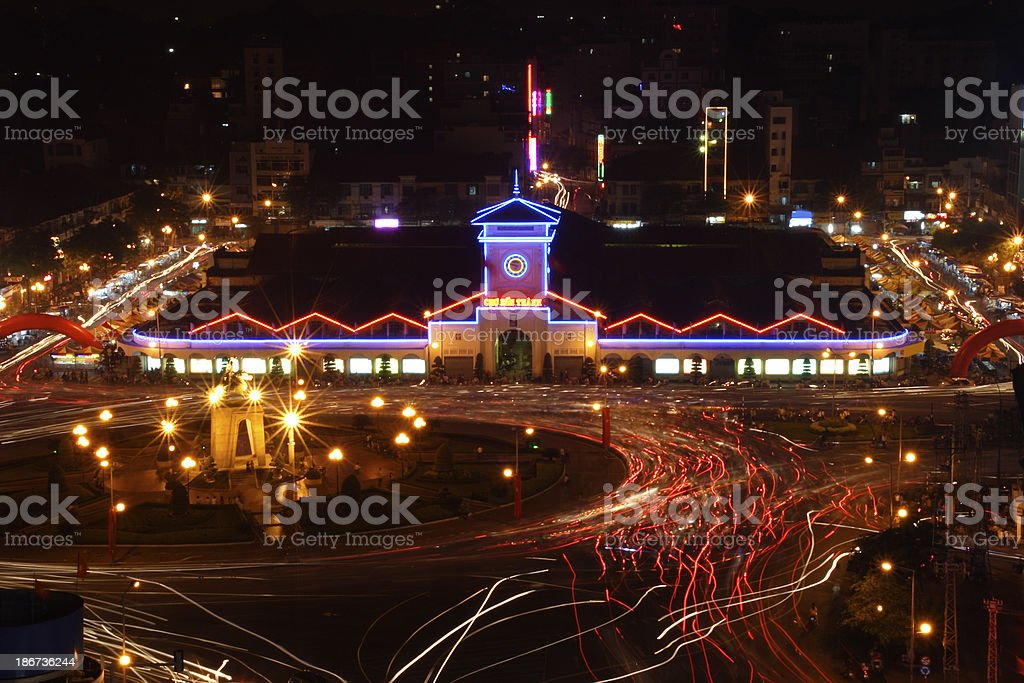 Ben Thanh market and busy Saigon roundabout at night royalty-free stock photo