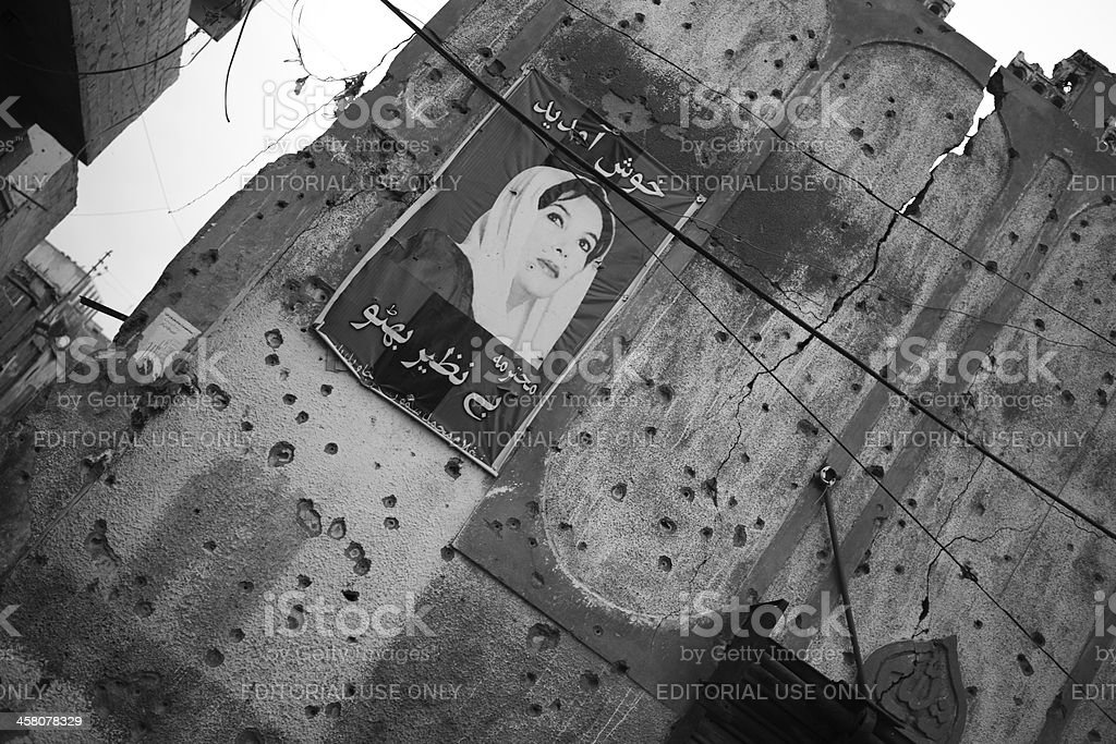 Benazir Bhutto's Portrait over Bullet riddled Wall of Lyari royalty-free stock photo