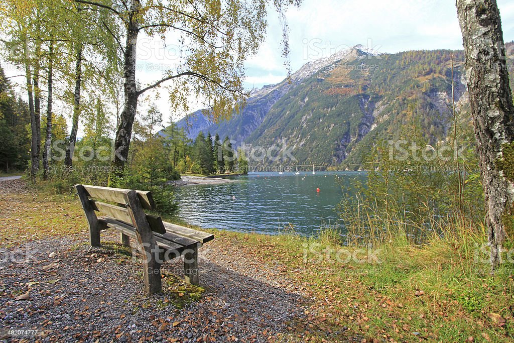 Bench along Achensee Lake in Tirol, Austria stock photo