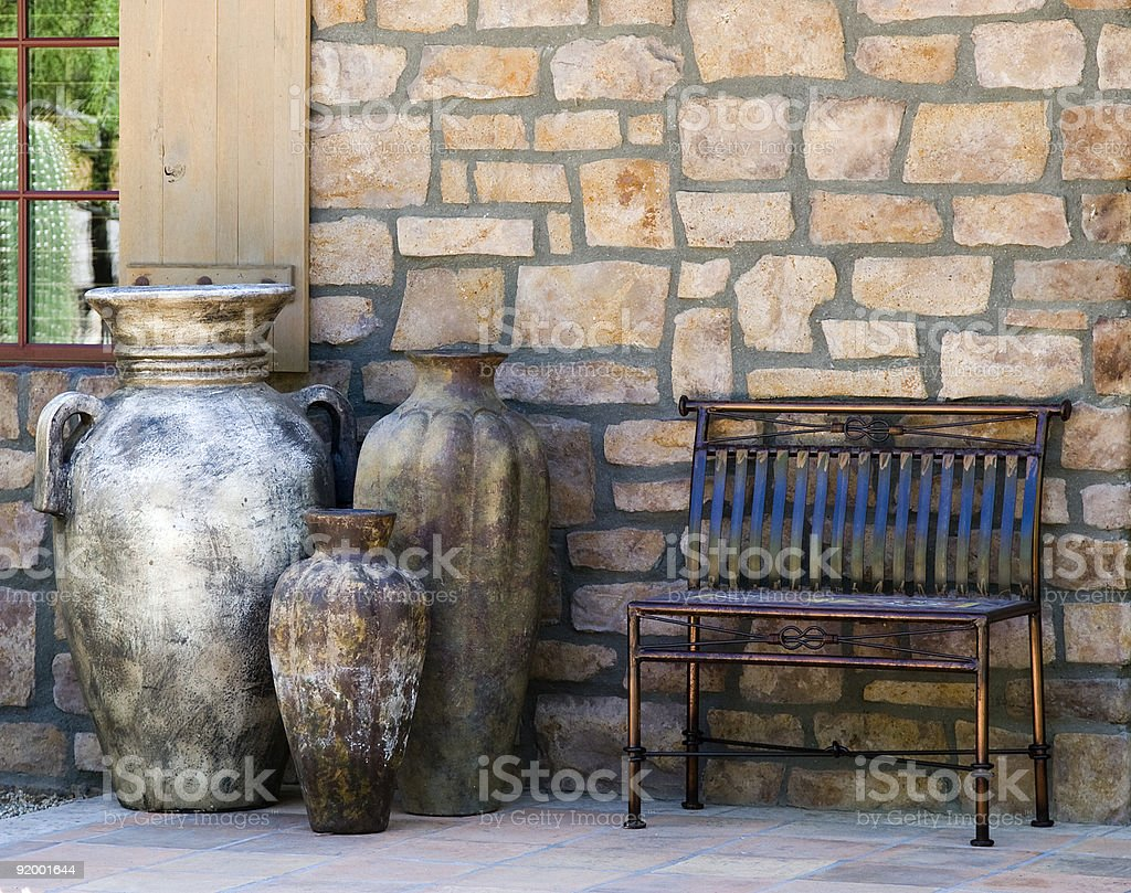 Bench and Decorative Urns royalty-free stock photo