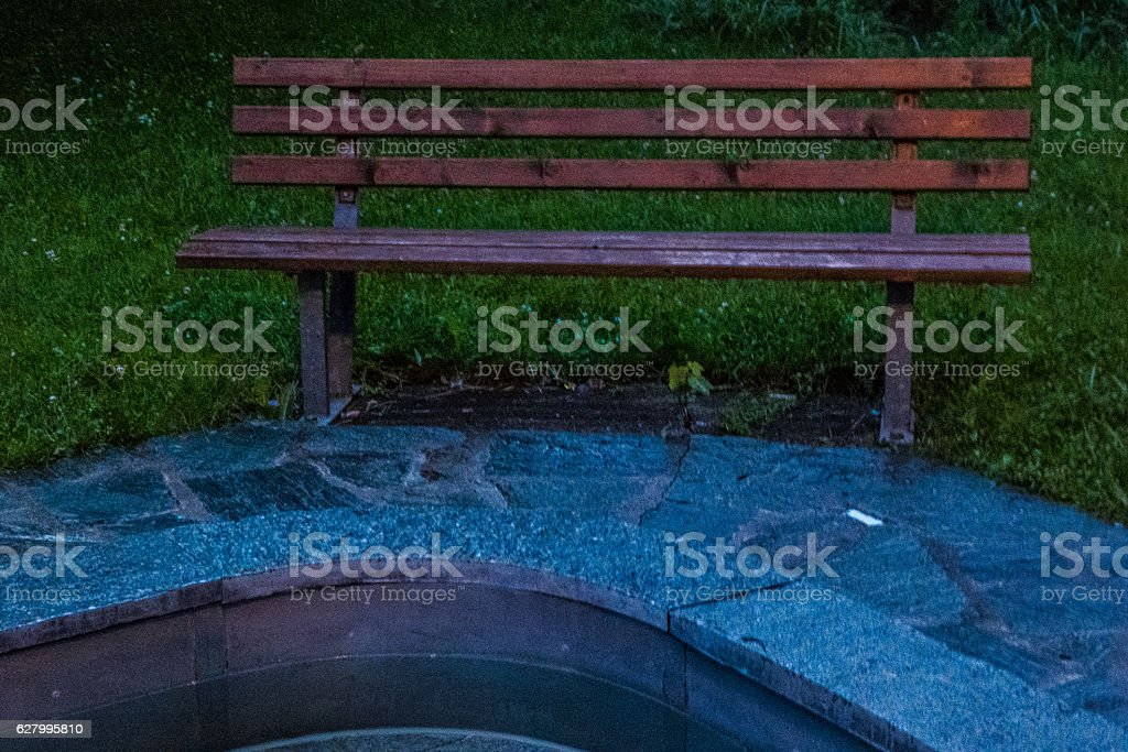 Bench and fountain stock photo