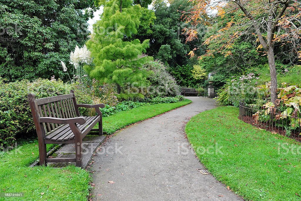 Bench and Pathway in a Formal Garden stock photo