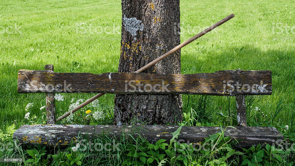 Bench and rake stock photo
