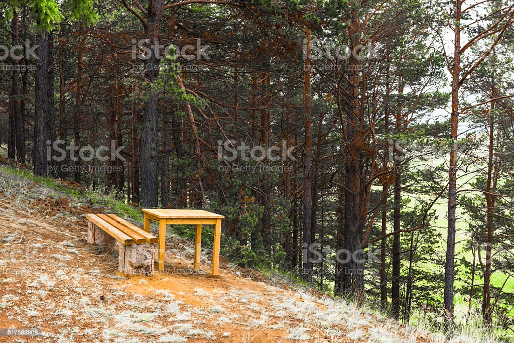 Bench and table on the edge of the cliff stock photo