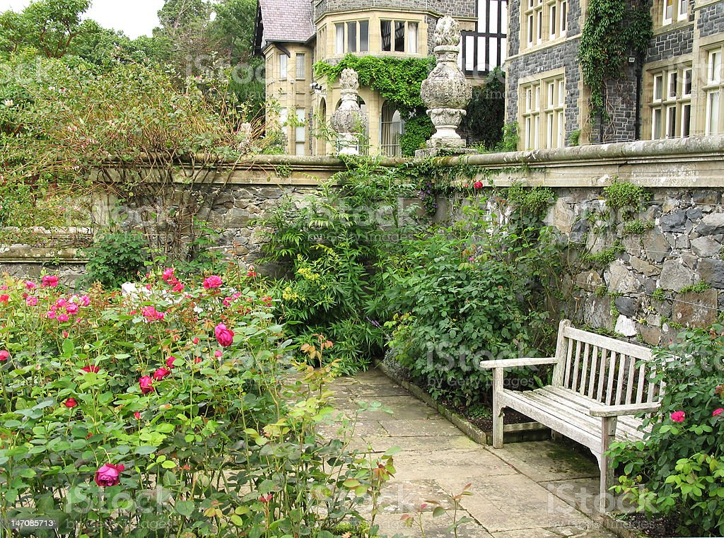 Bench at Bodnant Garden overlooking roses royalty-free stock photo