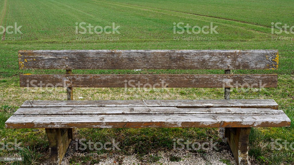 Bench at the field stock photo