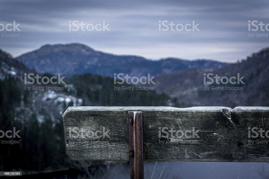 Bench between mountains stock photo