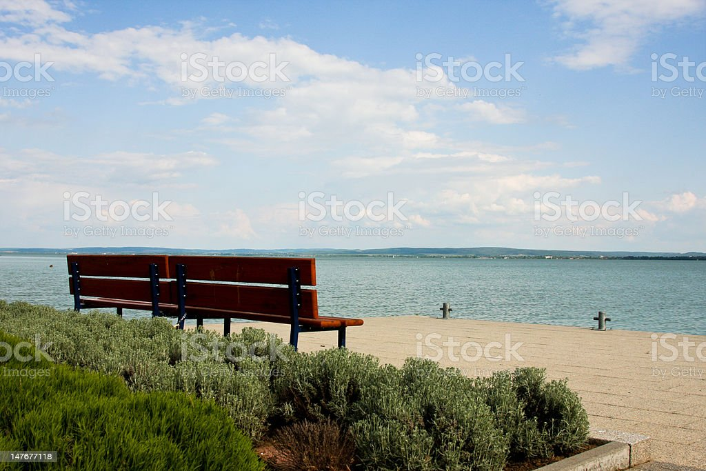 bench by shore royalty-free stock photo