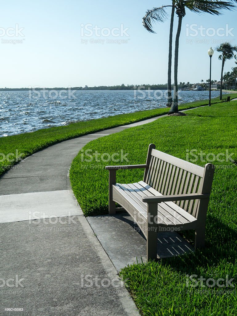 Bench by the ocean stock photo