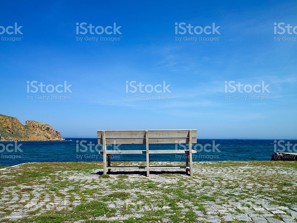 Bench by the sea royalty-free stock photo
