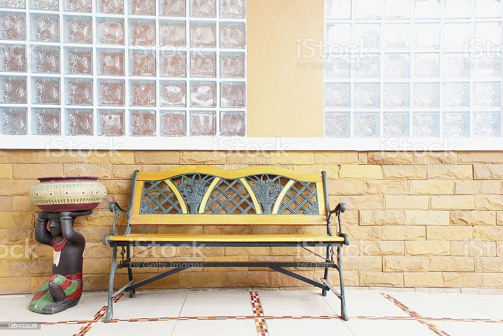 Bench by the wall. royalty-free stock photo
