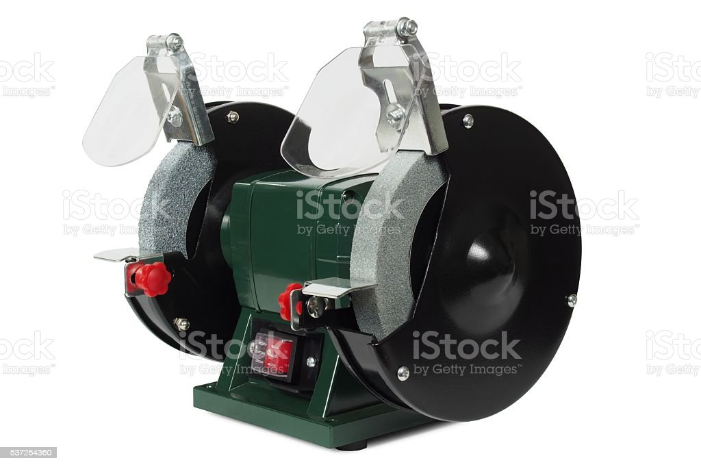 Bench grinder on white stock photo