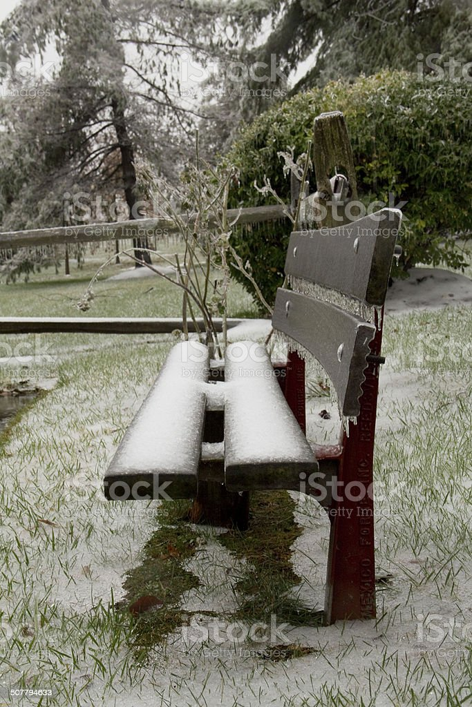 Bench iced over stock photo