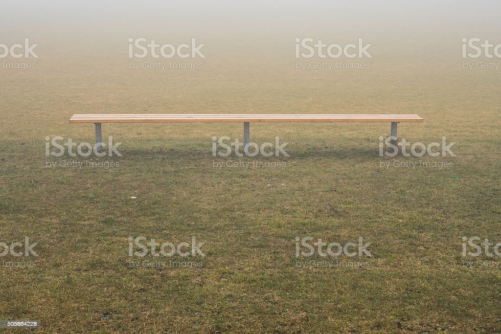 Bench in fog stock photo