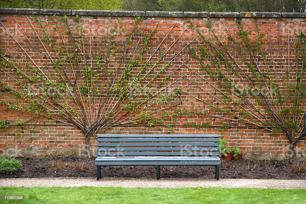 Bench in formal garden royalty-free stock photo