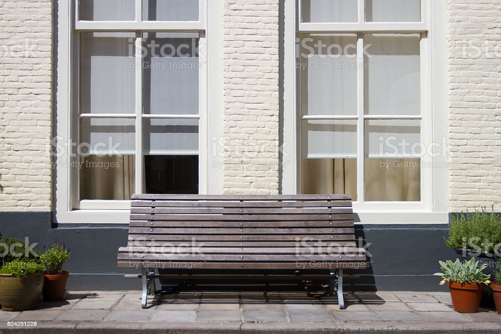Bench in front of a house, Midddelburg, Netherlands. stock photo
