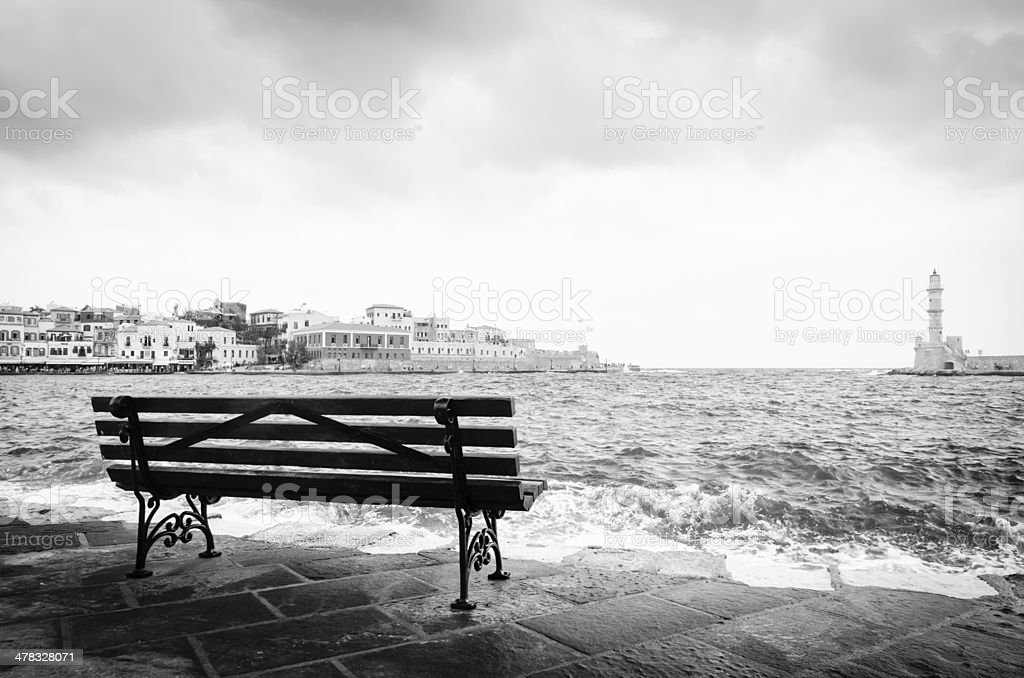 Bench in front of the sea stock photo