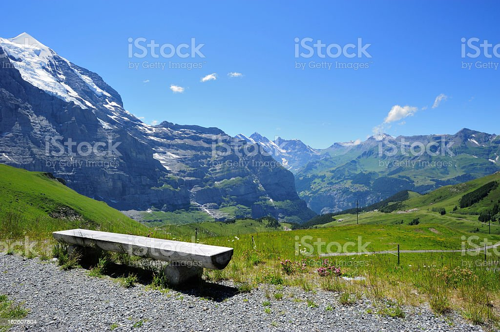 Bench in Swiss Mountains Region at Bernese Alps stock photo