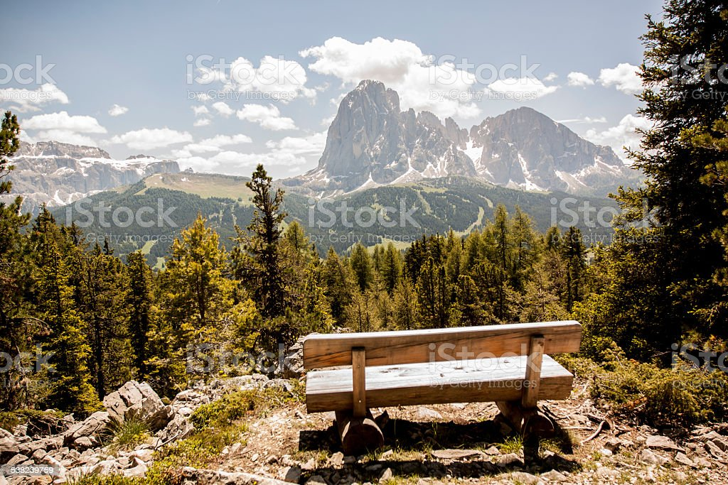 Bench in the mountains stock photo
