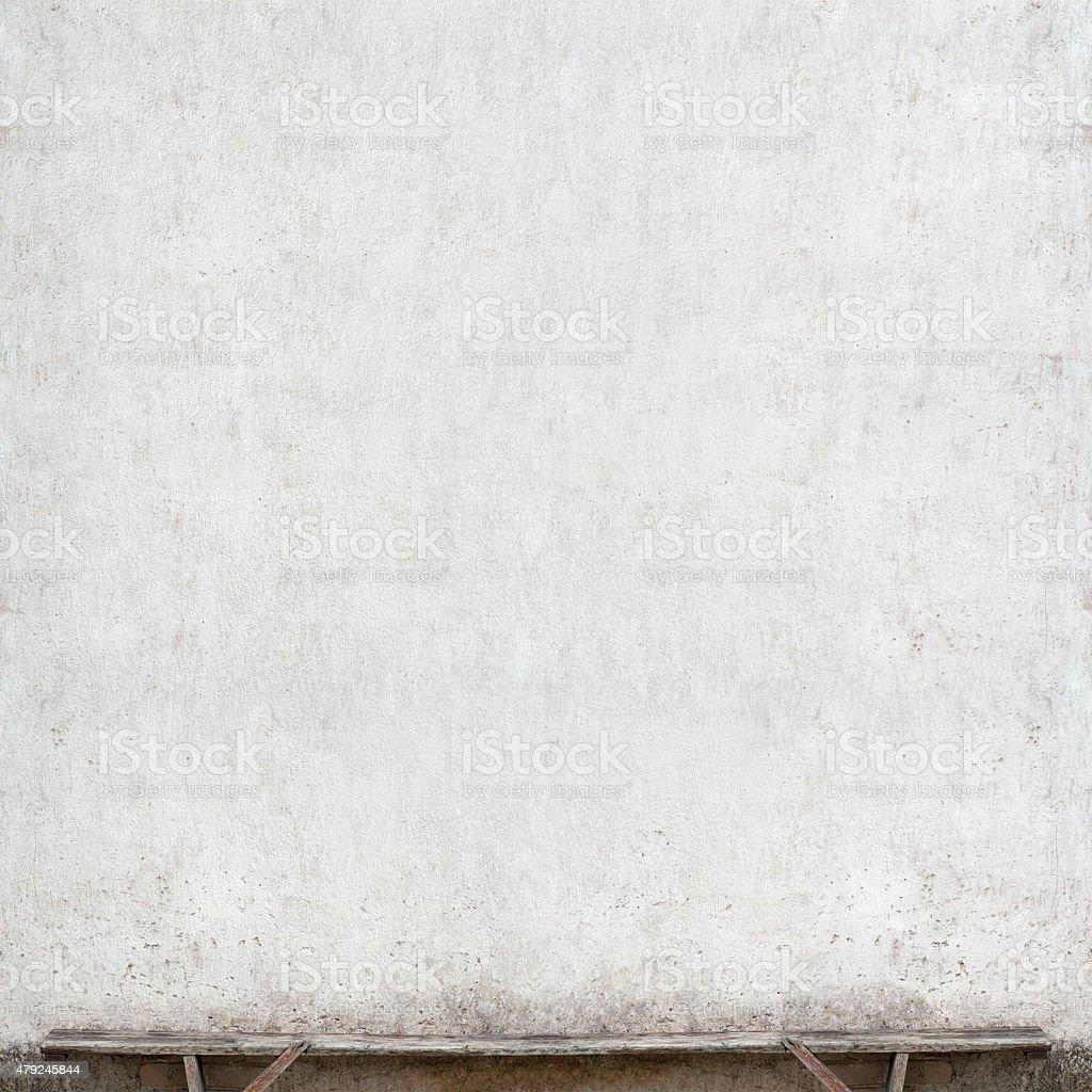 bench near the wall stock photo