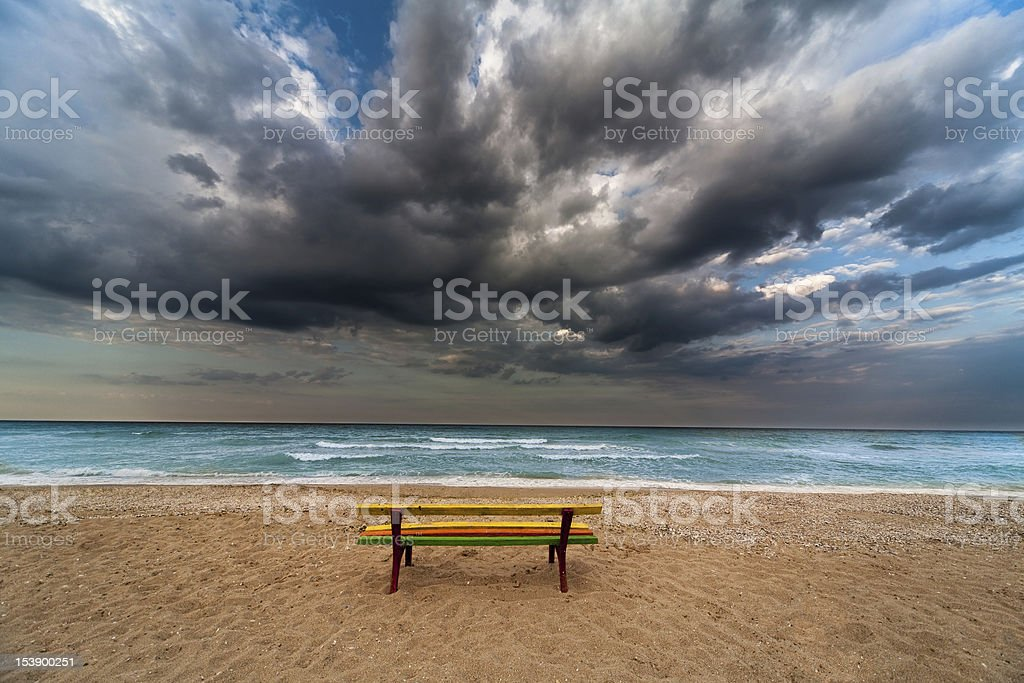 bench on a beach stock photo