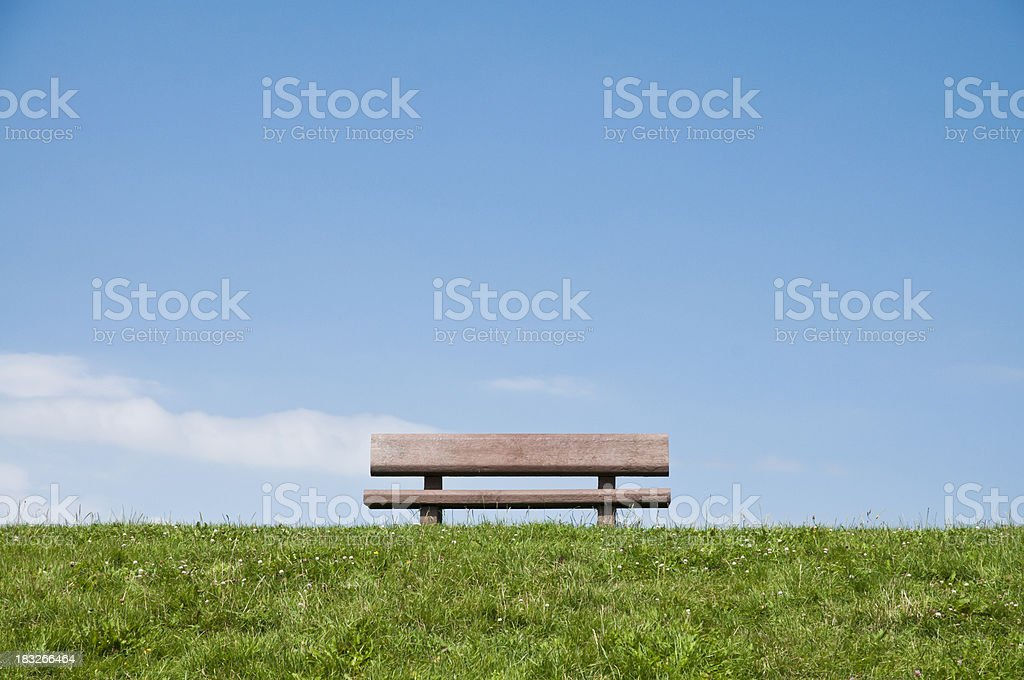 bench on a meadow royalty-free stock photo