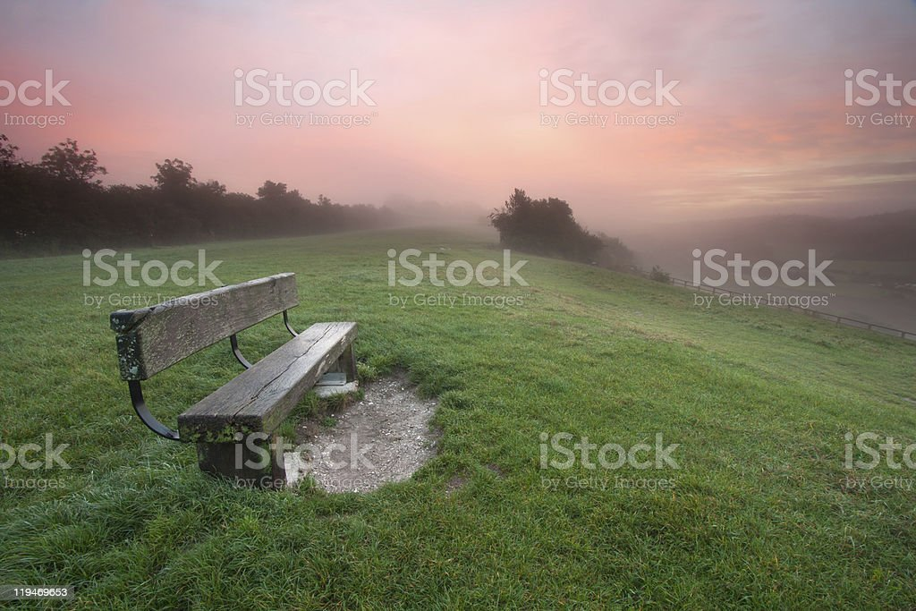 Bench on a Misty Dawn royalty-free stock photo