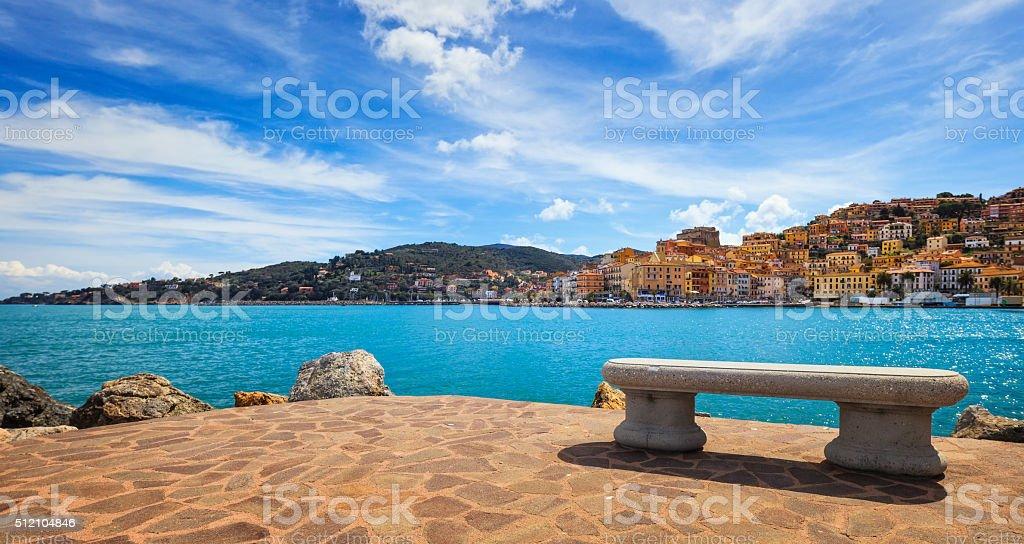 Bench on seafront in Porto Santo Stefano, Argentario, Tuscany, I stock photo