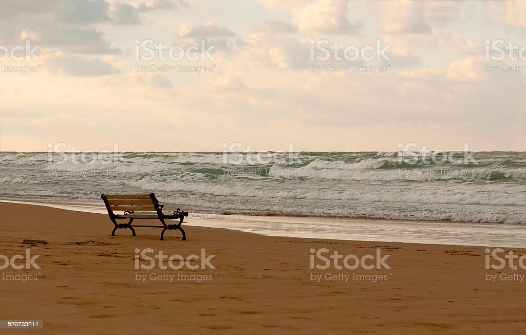 Bench on the beach stock photo