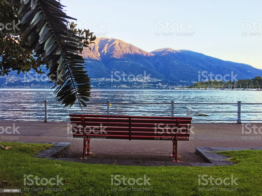 Bench on the lake Maggiore stock photo