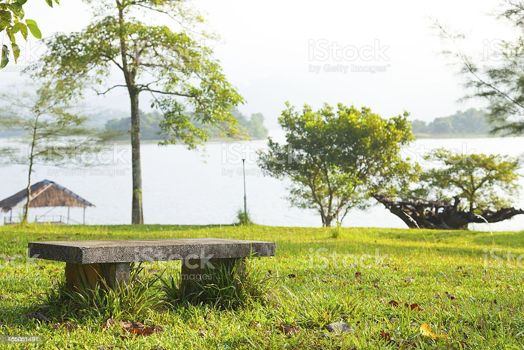Bench on the lawn. stock photo