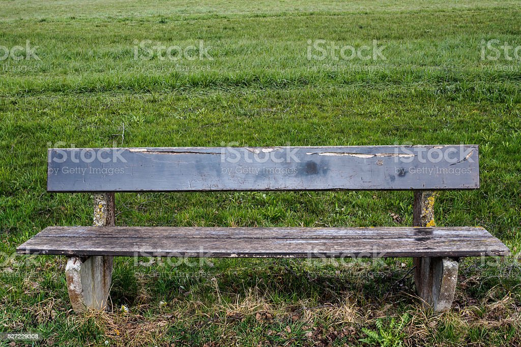 Bench on the meadow stock photo