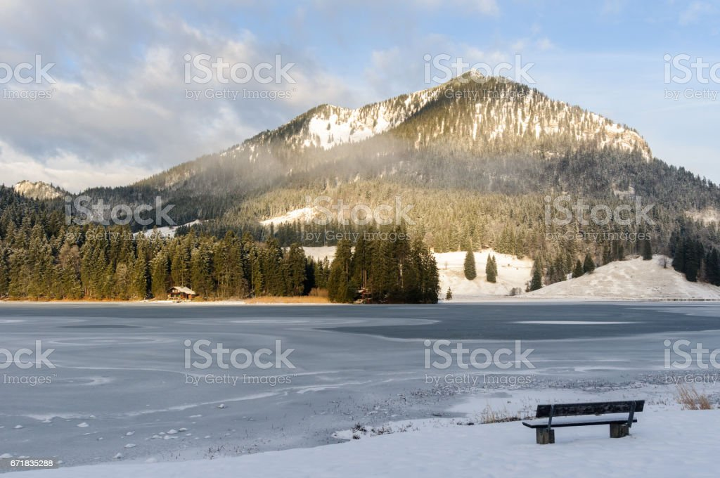 Bench on the shore of lake Spitzingsee in Bavaria, Germany stock photo