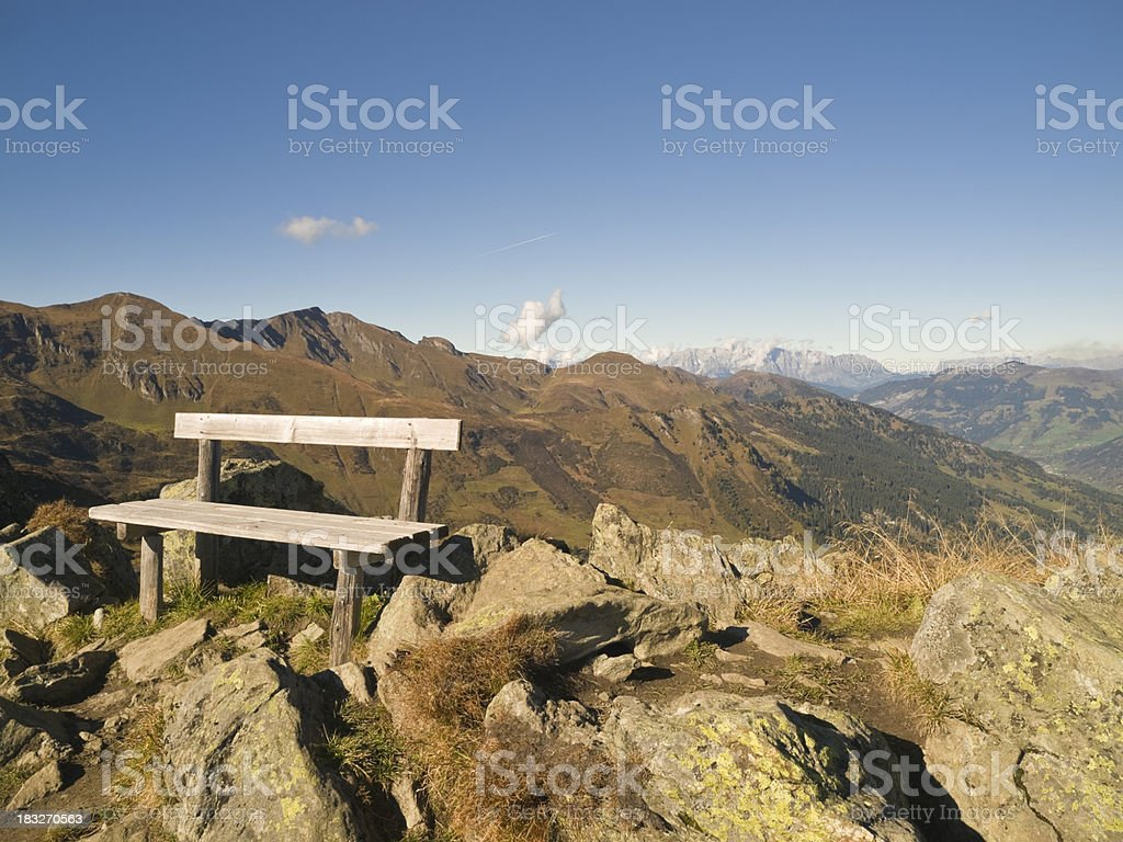 Bench overlooking mountains royalty-free stock photo