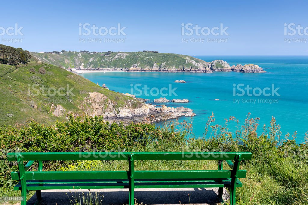 Bench overlooking south coast of Guernsey island, UK, Europe stock photo