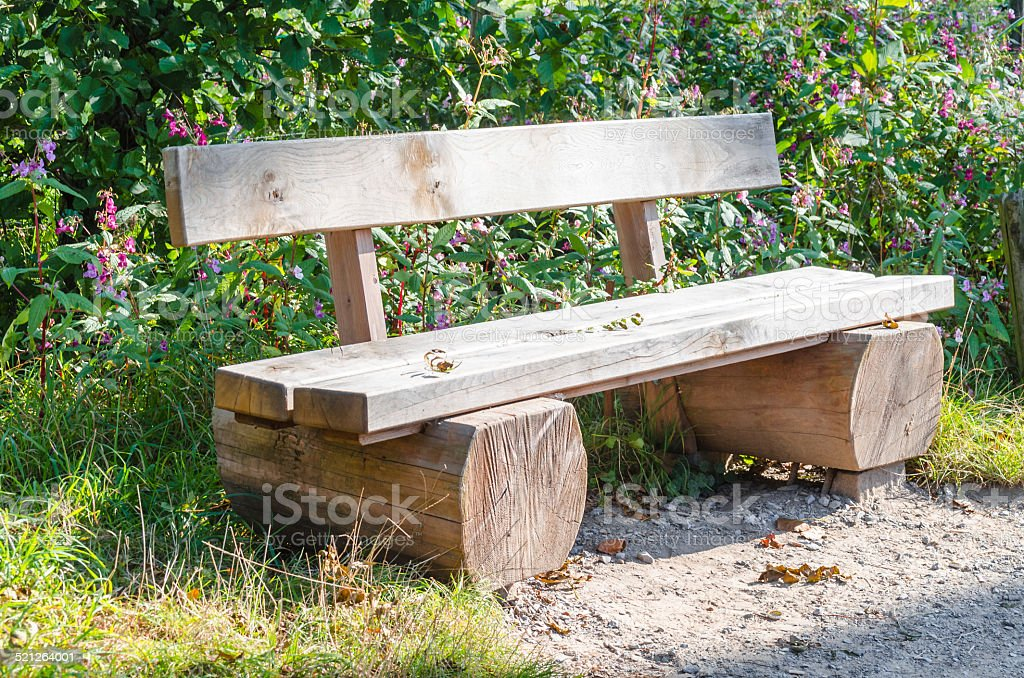 Bench, park bench made of solid tree trunk. stock photo