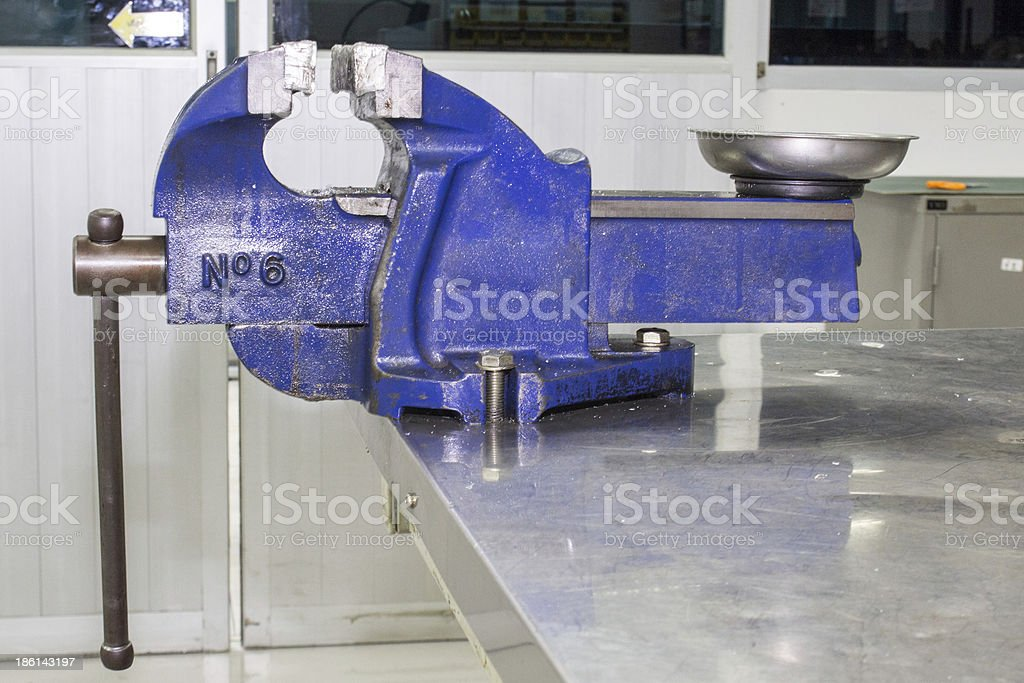 bench vise on table stock photo