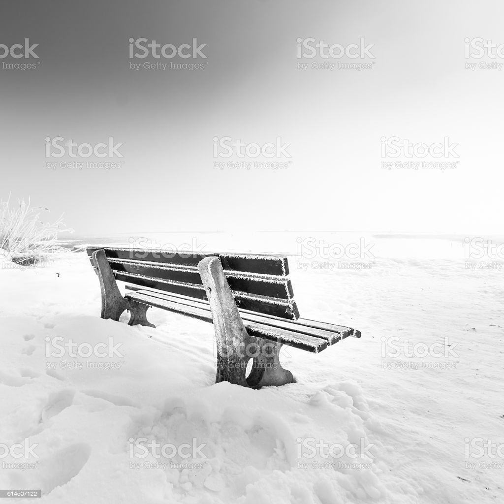 bench with ice lake chiemsee stock photo