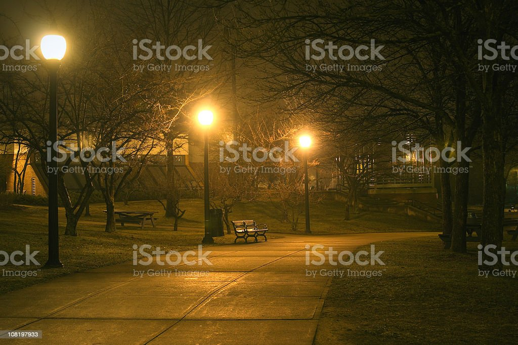 Bench With Lights in Park at Night stock photo