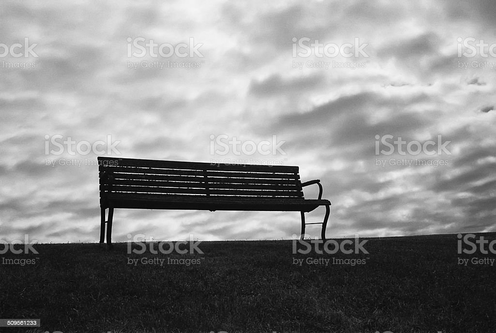 Bench With Ominous Sky stock photo