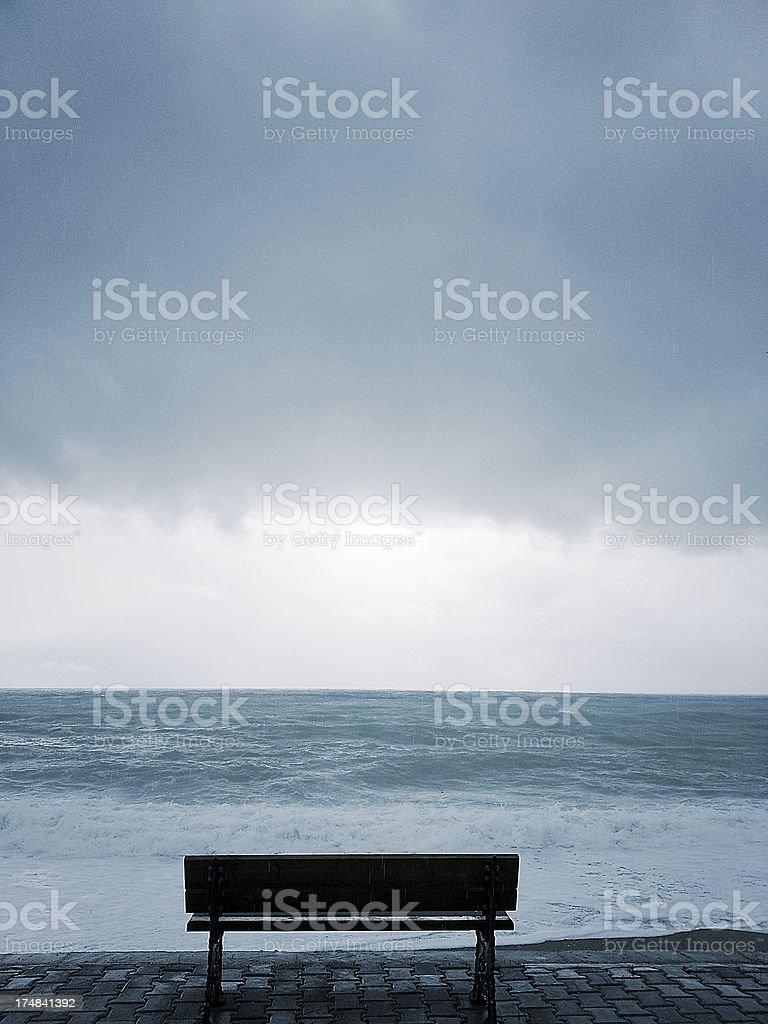 Bench with seastorm stock photo