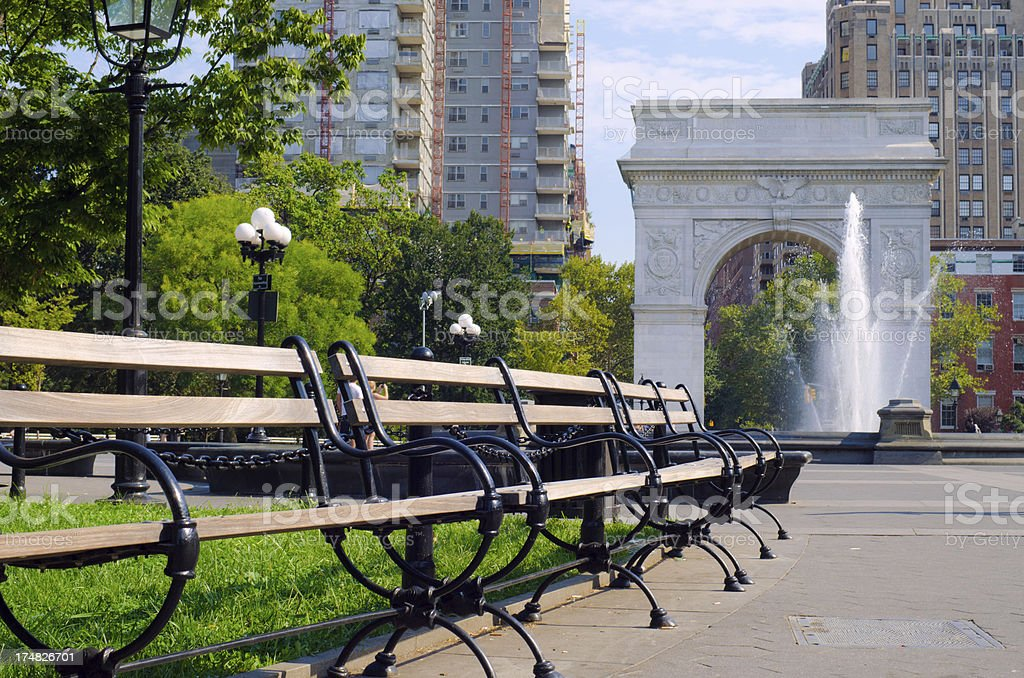 Benches and arch at Washington Square Park in Manhattan stock photo