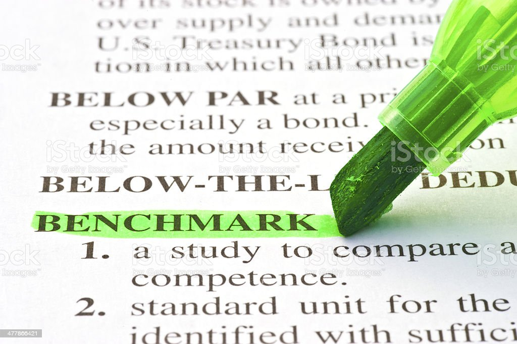 benchmark definition highligted in dictionary stock photo
