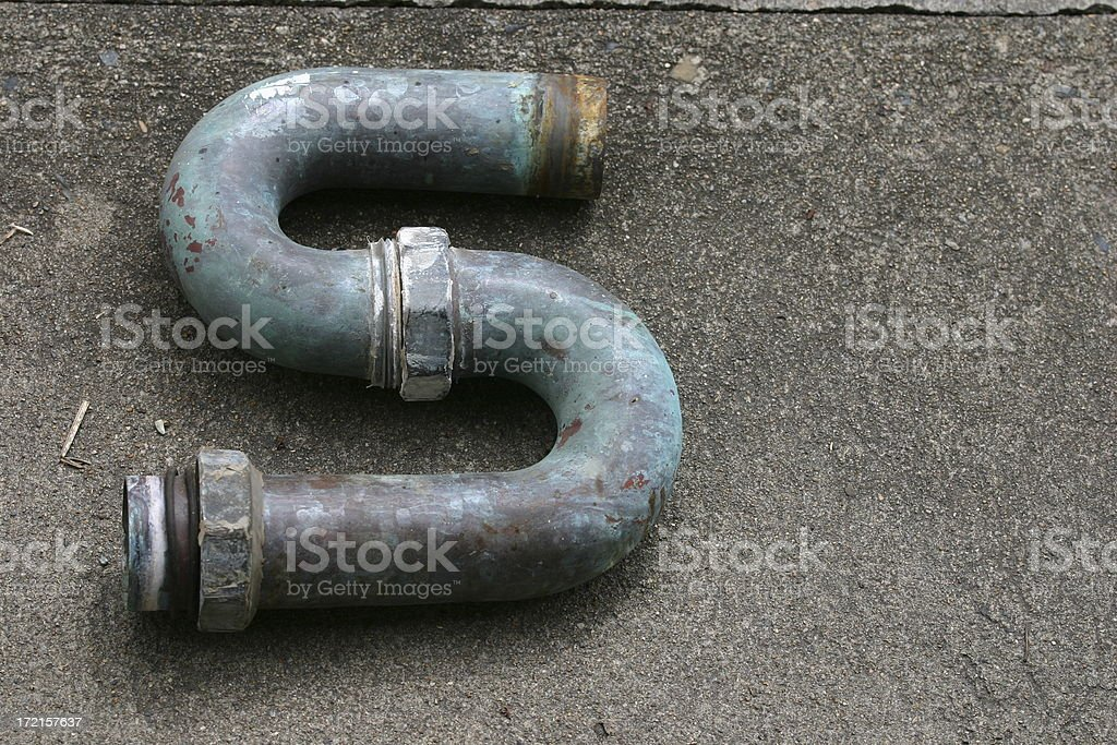 S bend pipe on concrete path stock photo