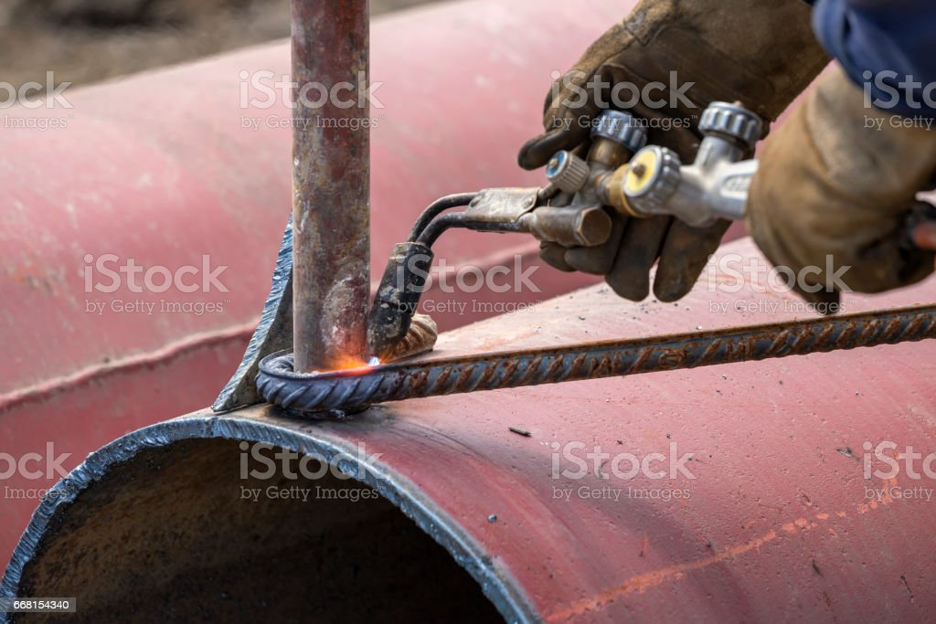 Bend rod with heat stock photo