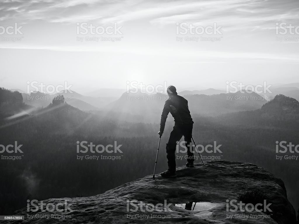 Bended man with broken leg and medicine crutch.  Hiker stock photo
