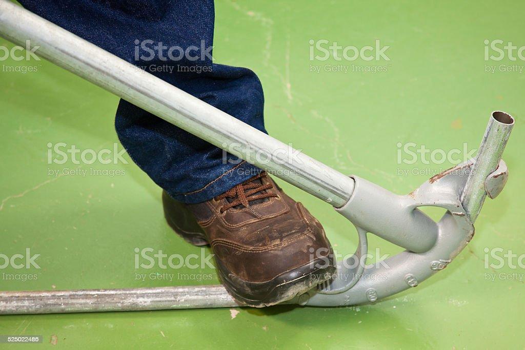 Bending a tube stock photo