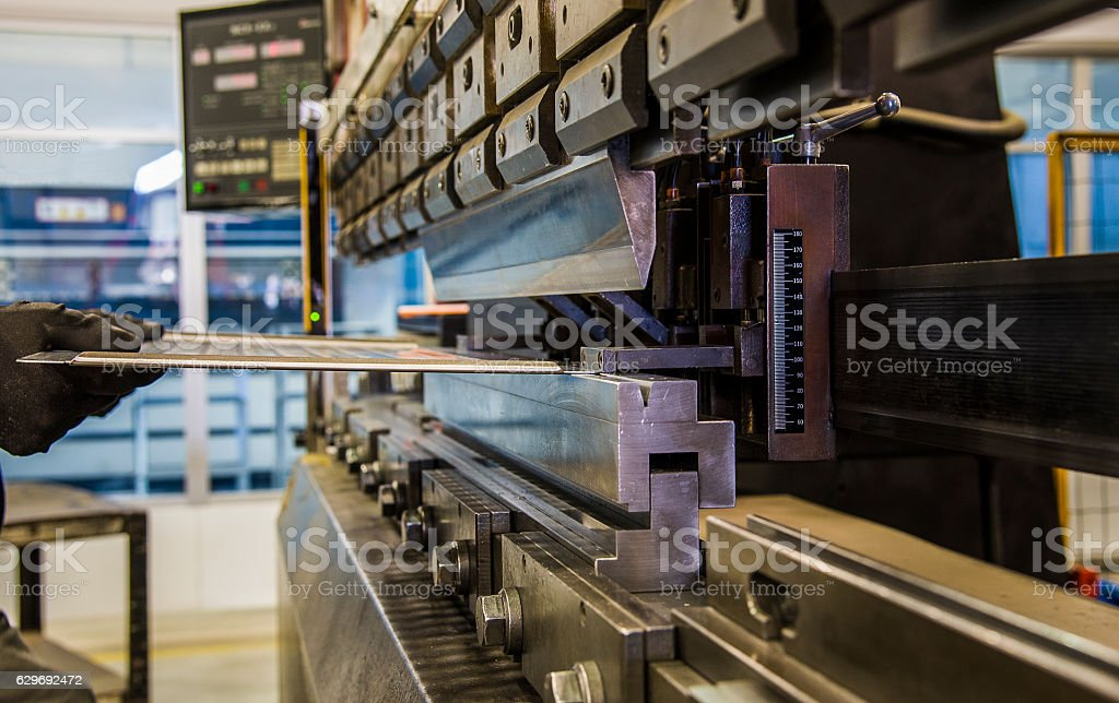Bending of metal on the machine. stock photo